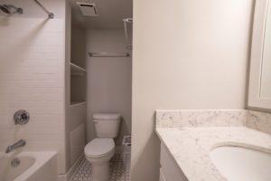 shower, toilet and sink viewed in bathroom