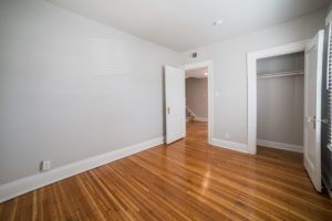 original wood floor in neutral colors for bedroom