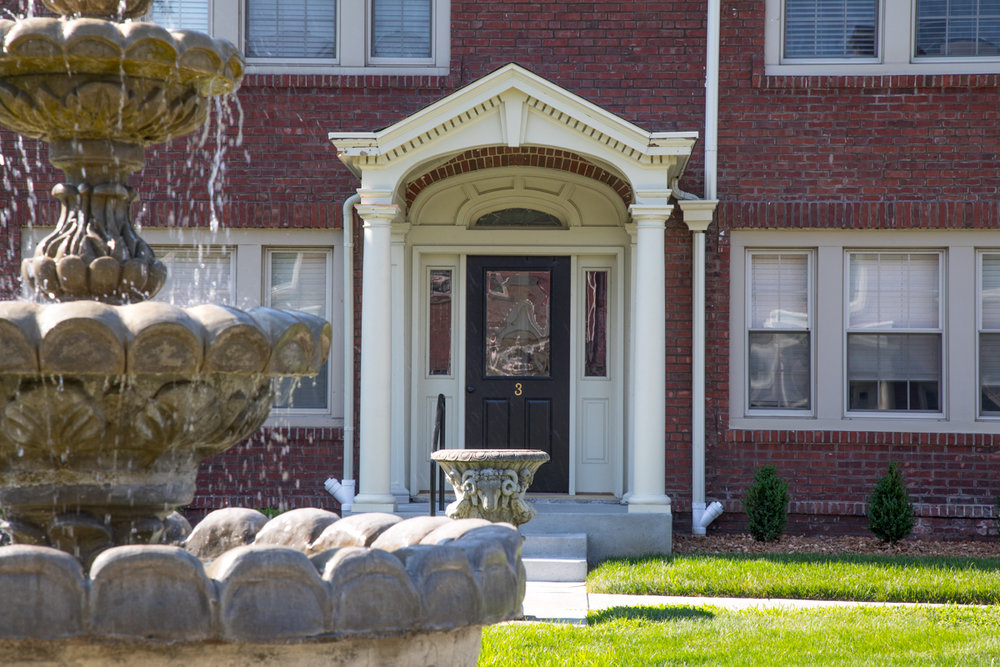 closeup of fountain in view of apartment entrance